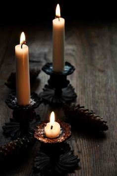 Candlelight. Dark candlesticks can be made from brass or other colors by using spraypaint suited for the surface application.