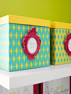 Decorative boxes - Store laundry supplies in attractive containers, such as these basic boxes that are covered with patterned paper and protected with a layer of clear adhesive-back paper. Make your own labels by spray-painting small inexpensive photo frames. Fill the frames with a description of what's stored in each box, then hot-glue the frames in place.