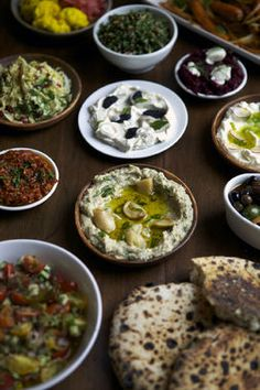 So many options to choose from! Shaya Restaurant in New Orleans has a plethora of mezza plates to order. We encourage you to try them all: Baba Ganoush, Israeli Salad, Labneh, Tabouleh, Ikra, and more. http://thestir.cafemom.com/food_party/189899/15_delicious_dishes_to_try