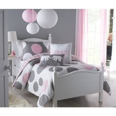 Upgrade your child's bedroom with this lovely twin-size comforter set. Featuring a whimsical pink-and-gray polka dot design, it is the perfect way to add a bit of charm to their space. This two-piece set includes the comforter and a standard sham.