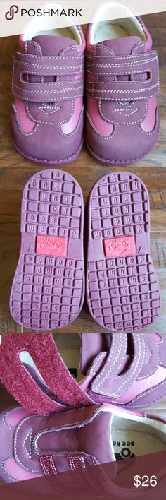 Worn Once! See Kai Run Henley Trainer Size 7 Two-toned berry themed trainer blends comfort and style. Handcrafted from butter-soft leather. Flexible rubber sole - healthy for developing feet but sturdy enougb for outdoor play! Generous width and wide toe box for plenty of wiggle room. Padded collars for extra comfort. Adjustable hook and loop closures for a custom fit and  easy on-off. Breathable leather insole and lining. Worn once, but I don't think they were ever walked in! See Kai Run…