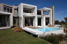 6 Sandy Bay - Une luxueuse villa de 5 chambres située à Llandudno, avec jardin, piscine et vue imprenable sur l'Océan Atlantique.