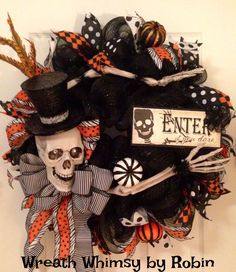 Enter If You Dare with this skeleton Halloween wreath. The skeleton head with mini top hat captures your attention, while the arms and hands cradle a wood sign. Embellished with beautiful black, orange and white ribbon and coordinating decorative pumpkins. This wreath measures approximately 26-28 inches.    SPECIAL DISCOUNT - If you want to purchase the coordinating witch wreath shown in the door photo above I will sell you both wreaths for $100/each. Contact me to discuss details before…