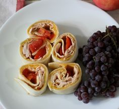 Turkey Pinwheels #SunaySupper - A simple cheesy tortilla filled with turkey and tomatoes and cut into slices. A perfect, quick lunch.