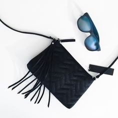 Black Chevron Embossed Crossbody Bag Great for the night out, comes with a tassel embellishment, strap is not adjustable or removable. Comes with a pocket and zipper compartment inside the bag. MAKE ALL OFFERS THROUGH THE OFFER BUTTON & NO TRADES Boutique Bags Crossbody Bags