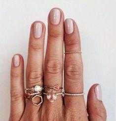 rose gold rings and wedding rings. nude fingernail polish