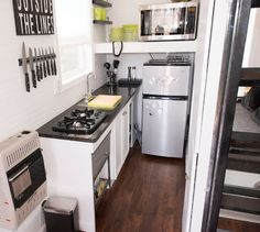 Sweet little ♕ tiny house kitchen all in white with shelves on either side of the stove. Description from pinterest.com. I searched for this on bing.com/images