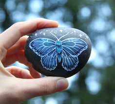 Good Morning Light Seekers!  I'm drinking coffee, listening to soul music, and ready for today's shop update at 9:00am (PST). See you soon!  (Steady in the Dark; a Moth Stone. Acrylic and watercolor on found river stone)