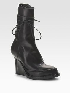 I love the quirkiness of this designers boots... the placement of the heels and the lacing in particular are very interesting.