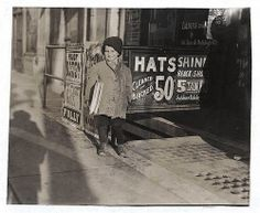 Five year old Hymie Miller, newspaper seller after school, photo by Lewis Hine