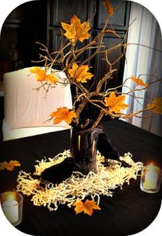 Black ravens and tree branch with silk fall leaves = Great Halloween centerpiece