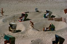 Sunbathers find shelter from North Sea breezes. 1977