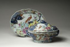 Rare Chinese Export Porcelain 'Tobacco Leaf' Tureen, Cover and Stand, 1775-85 - Painted in enamels, gold & underglaze-blue in the typical pattern of leaves & flowers, but including tree squirrels & pairs of pheasants. Length of tureen 9 7/8 inches.