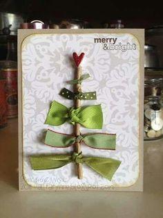 Tarjeta de navidad: una pequeña rama, cinta verde de distintos colores y cartulina