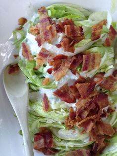 Slivered Wedge Salad with Buttermilk Dressing and Bacon: Good old iceberg lettuce, a creamy dressing, and fat crumbles of bacon. Retro happiness.  From themom100.com