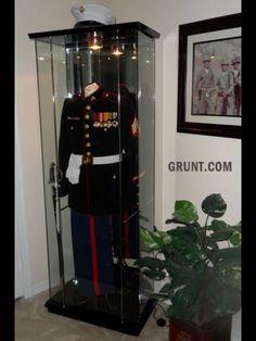 USMC man cave by Sgt. Dan Sheffer via Grunt.com.   Awesome way to display dress blues!