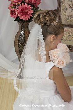 Beautiful first communion lace trimmed mantilla with scattered pearls. Shamrock tiara sold separately. In stock now at Christian Expressions