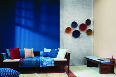 Highlight beauty of Indigo dyed textiles with 7357 Emphasis Colour on wall. Use handmade local crafted baskets as wall accessories.  Colours: 7357 Emphasis, 8473 Oyster Grey, Archi concrete 8297 Platinum Disca