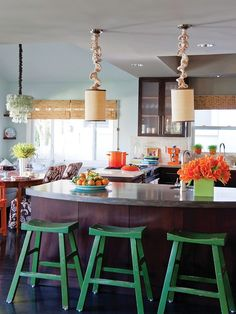 More excellent colour in a kitchen, funky green and orange looks great.