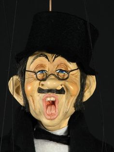 """""""The Singer"""" from The Marionette Shop."""