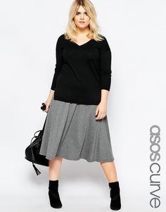 You definitely need some basic go-to skirts. I would look for a high waistline and fullness - it's the most comfy and when your skirts flare out they are more forgiving. I like this skirt because it's also jersey and it's long enough that you can go without leggings.