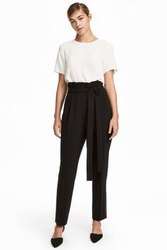 Check this out! Pants in woven fabric with a removable tie belt and pleats at top. High waist and zip fly with hook-and-eye fastener. Side pockets, mock back pockets, and tapered legs with creases and stripes at sides. - Visit hm.com to see more.