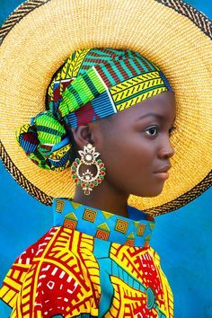Always Forward - - African girl in bright colorful headwrap and hat.