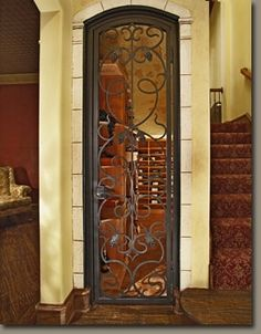 door- wider but good weight for ironwork...   somethingcreative Wine Cellar ~ Limestone Entrance