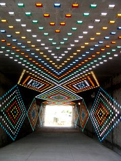 """4000 roadway safety reflectors for """"Thunder Over The Rockies"""", the world's first reflectorized art tunnel by Richard C. Elliott. Belleview Station in Denver"""