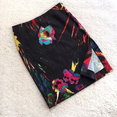 "Versace Jeans Couture Neon Print Skirt✨HP✨ ELECTRIC abstract flowers on a black stretch denim pencil skirt! This is a thin but structured denim material. Two back pockets and a side slit on the left side. Invisible side zipper. Unlined. 75% cotton; 22% polyester; 2% other. Machine wash, line dry. Size 42 IT (US 6/28). Waist: 14.5"". Hip: 18"". Length: 21.5"". Rarely worn and in excellent condition. Thanks for looking! Versace Skirts Pencil"