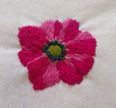 This sample shows a single flower in red with pink highlights. The embroidered center is circled with beads. You choose your own colors!    For years I've embellished my clothing to develop my own style. I would love to help you make personal changes to anything that will take to needle and thread. Contact me today. What article of clothing or accessory can I help you make into your own unique item? Check around my shop to see additional works for ideas. You choose the colors and the style…
