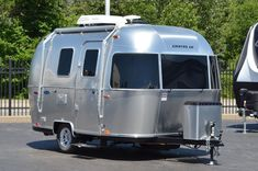 We've compiled a list of the top 5 best travel trailers UNDER pounds. You'll love the ability to tow an RV with your small pickup or large SUV! Light Travel Trailers, 5th Wheel Travel Trailers, Travel Trailers For Sale, Tiny Trailers, Camping Trailer For Sale, Travel Trailer Camping, Trailer Sales, Large Suv, Small Suv