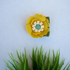 Mustard and Turquoise  A mustard and turquoise felt flower is attached to a gray lined clip. D E T A I L S ○ mustard and turquoise felt flower ○ approximately 3 long in diameter ○ attached to gray ribbon lined alligator clip ○ each piece is carefully designed & handcrafted  more clips: http://etsy.me/2t0CB8j  W A Y S T O S T Y L E ○ pulling the bangs or hair back to the side ○ under a bun ○ to the side of a bun ○ tie hair back half up and put near hair elastic   P R O C E S S I N G About 4…