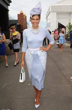 All dressed up: Ashley was the epitome of ladylike at the Melbourne Cup in November last y...