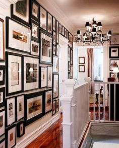 I want my upstairs hallway to look like this. House and Home While most people start gallery walls from the center point and work their way out, I like how they started this one by lining the frames up at the top and working down. Style At Home, Upstairs Hallway, Hallway Art, Upstairs Landing, Hallway Ideas, Long Hallway, Hallway Pictures, Framed Pictures, Modern Hallway