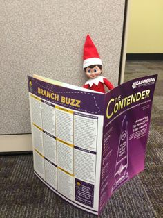 Happy Monday! The Elf on the Shelf is checking out the latest edition of The Contender.