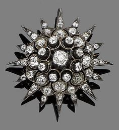 A diamond star brooch/pendant, circa 1890  Designed as a sixteen-rayed star, set throughout with old brilliant-cut and cushion-shaped diamonds, mounted in silver and gold, diamonds approx. 2.00cts total, length 3.8cm