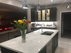 This is our beautiful Caesarstone Statuario Maximus quartz counter top with Blanco Silgranite sinks and IKEA Laxarby Black cabinets.