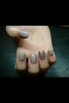 Grey nails with sparkle.