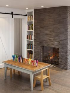 The texture of the stacked taupe stone has a cool ripple effect. You can feel good knowing that stone is one of the safest materials for fireplaces because it's fireproof and durable.