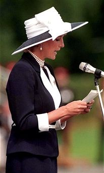 Princess Diana (1961 - 1997) giving a speech during a visit to present new colours to the Light Dragoon Guards at their base in Bergen-Hohne in northern Germany, July 1995. She is wearing a Catherine Walker suit and a hat by Philip Somerville.