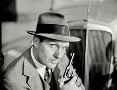 """1960. """"Robert Stack in his role as Eliot Ness on the television program The Untouchables."""" Photo by Earl Theisen for the Look magazine artic..."""