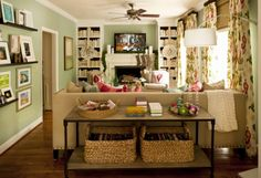 living room anne turner carroll // love the color and the table behind the couch.