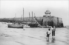 Ives, Cornwall A view of Smeaton's Pier at low tide (before the extension), with a couple of local lads carefully posed by the photographer (most likely L. St Ives Cornwall, Devon And Cornwall, Vintage Photographs, Vintage Photos, Paris Skyline, New York Skyline, Wooden Boats, Far Away, Old Photos