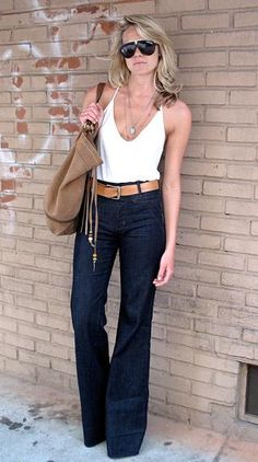 The wide leg, high waisted, dark denim paired with the loose, plunged top. Ideal everyday wear for the long legged, petite breasted girls like myself. Effortless yet conscious.