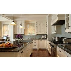 kitchens - blue gray glass subway tiles backsplash ivory glass-front cabinets oil rubbed bronze hardware black granite countertops bamboo roller shades found on Polyvore