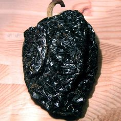 Ancho Chili Pepper. 1,000 - 2,500 Scoville Units. Capsicum annuum. Ancho Chili is the dried form of the poblano chili pepper. The ripened red poblano can be hotter and more flavorful than the less ripe, green poblano. Ancho chiles have a deep red color and a wrinkled skin. Anchos are sweet and smoky with a flavor slightly reminiscent of raisins.