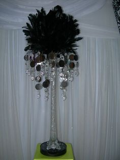 Aglow Weddings & Events.  Black Feather Ball Centerpiece with Silver Gem Vase Topper
