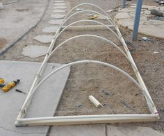 PVC Greenhouse. Doesn't require the PVC fixed to the sides of the bed. Just anchor.