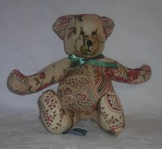 Priscilla. She is made from a floral linen fabric and a cotton paisley. www.facebook.com/TBearspicnic